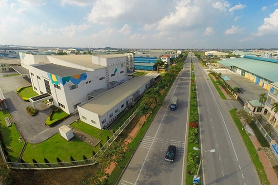 COVID-19 has caused temporary difficulties for upcoming business plans, but with a long-term investment strategy, industrial real estate in Vietnam is still very attractive. —Photo doanhnghiepphattrien.vn