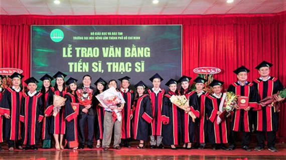 New masters and doctors of HCMC Nong Lam University receiving their degrees on October 31