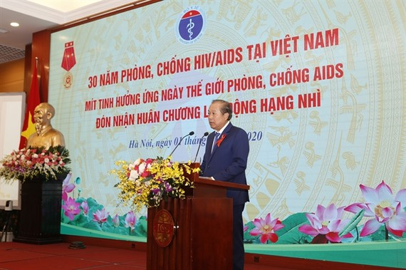 Permanent Deputy Prime Minister Truong Hoa Binhspeaks at a meeting to mark the World AIDS Day 2020 (December 1) and review 30 years of HIV/AIDS prevention and control in Vietnam on Tuesday. —Photo Ministry of Health