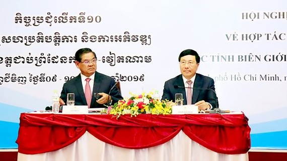 Deputy Prime Minister cum Minister of Foreign Affairs of Vietnam Pham Binh Minh and Deputy Prime Minister cum Interior Minister of the Kingdom of Cambodia Sar Kheng