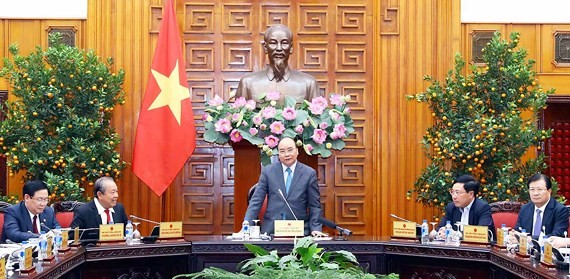 Prime Minister Nguyen Xuan Phuc (standing) speaks at the meeting of the Government standing board (Photo: SGGP)