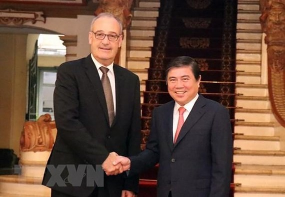 Chairman of the Ho Chi Minh City People's Committee Nguyen Thanh Phong and Minister of the Federal Department of Economic Affairs, Education and Research (EAER) of Switzerland Guy Parmelin