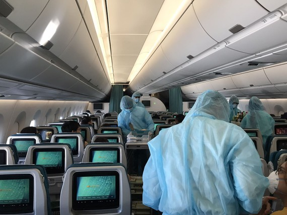 All the crew members in the flight are equipped with full-body medical protective gears