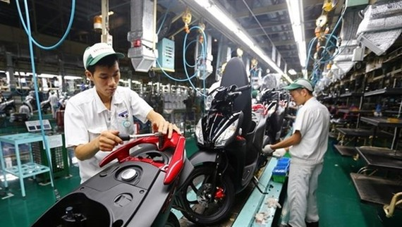 The national programme is considered a new push to support enterprises in the context of the Fourth Industrial Revolution (Photo: vietq.vn)