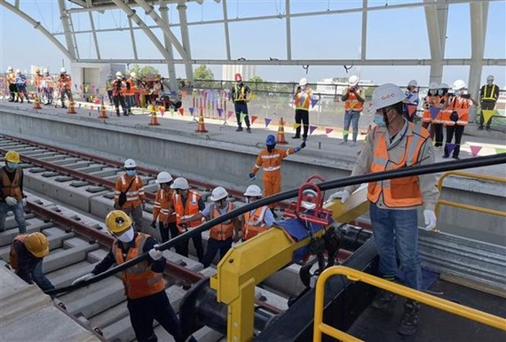 Cable pulling work on HCM City's Metro Line No 1 (Photo: VNA)