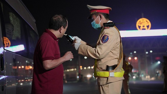 Police officer tests blood alcohol level of a driver