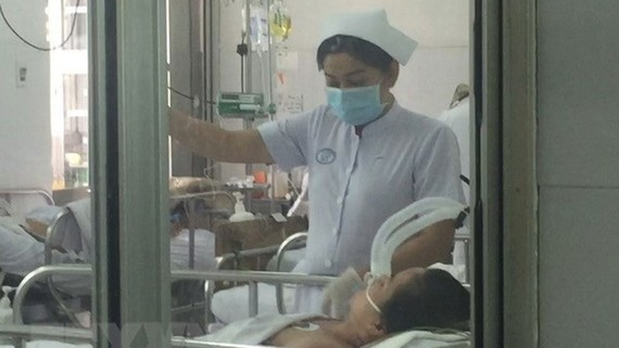 Bệnh nhân nhiễm cúm A/H1N1 điều trị tại Bệnh viện Chợ Rẫy. Ảnh: TTXVN