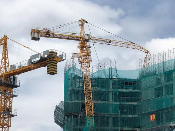 Hiện trường vụ gãy cần trục tháp xây dựng ở một công trình tại quận 8, TPHCM, tháng 6-2018. Ảnh: CHÍ THẠCH