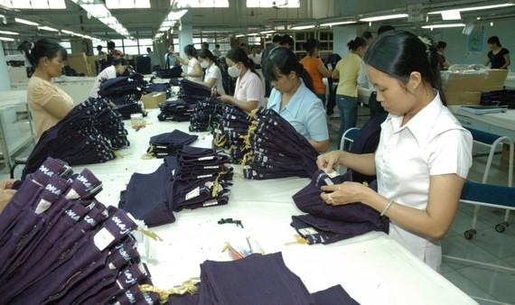 Dệt may chưa tận dụng được nhiều lợi thế của FTA để xuất khẩu. Ảnh: THÀNH TRÍ