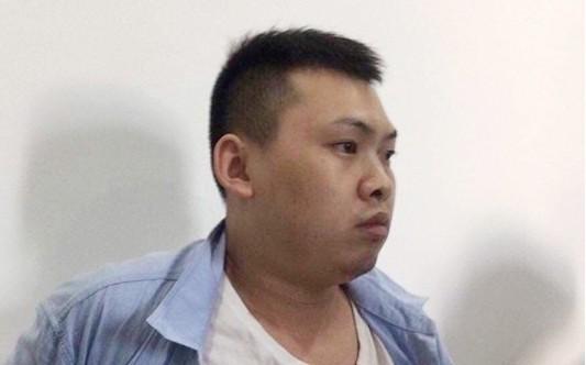 Đối tượng Xiao Qui Ping tại cơ quan công an. Ảnh: CA cung cấp