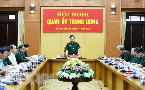 黨中央政治局委員、中央軍委副書記、國防部長吳春歷大將在會議上發表講話。(圖源:越通社)