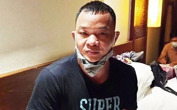 涉嫌組織外國人非法入境越南的犯罪嫌疑人Gao Liang Gu被扣押起訴。(圖源:警方提供)