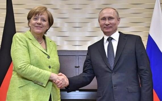 德國總理默克爾和俄羅斯總統普京。(圖源:俄羅斯新聞社圖片)