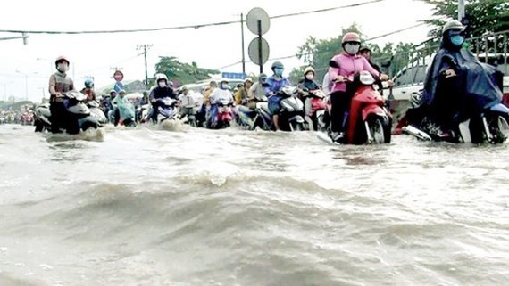 Flooding is one of issues much reflected by residents in HCMC but has been solved slowly (Photo: SGGP)
