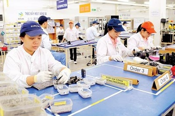 Workers at Misumi Group Company in Linh Trung export processing zone, HCMC (Photo: SGGP)