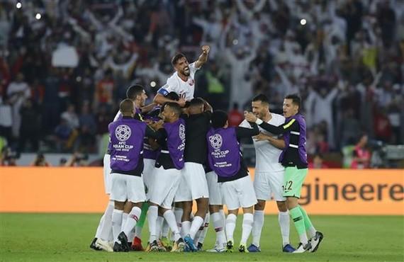Qatari players celebrate their victory (Photo: Xinhua/VNA)