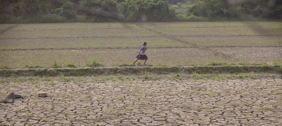 A girl runs through deserted farmland in Myanmar's Sagaing region where floods buried valuable fertile soil under several feet of mud which later dried hard and cracked, making land preparations very difficult and expensive (Photo: news.un.org)