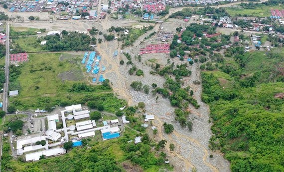 This aerial photo shows the area affected by flash floods in Sentani, Papua province, Indonesia, on March 18, 2019. Flash floods and mudslides triggered by downpours tore through mountainside villages in Indonesia's easternmost province, killing dozens of