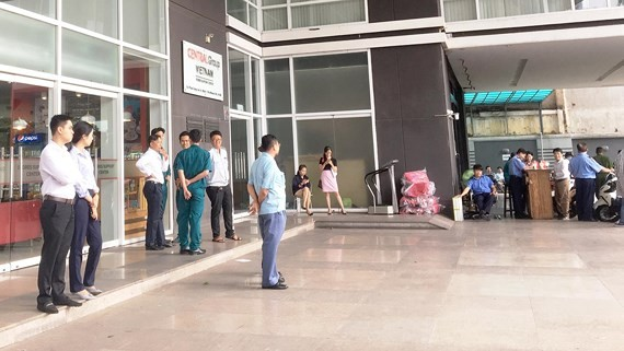 Representatives of some garment and textile firms wait for leaders of Central Group Vietnam at the group's headquarters in HCMC on July 3 (Photo: SGGP)