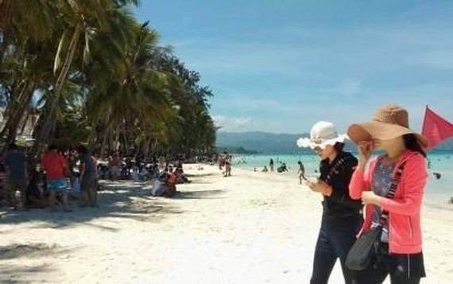 Tourists on a Philippine beach (Source: https://www.pna.gov.ph)
