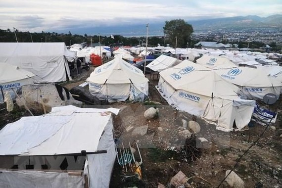 Temporary shelters for displaced people, set up after the earthquake and tsunami in the village of Balaroa, are still in use. (Photo: AFP)