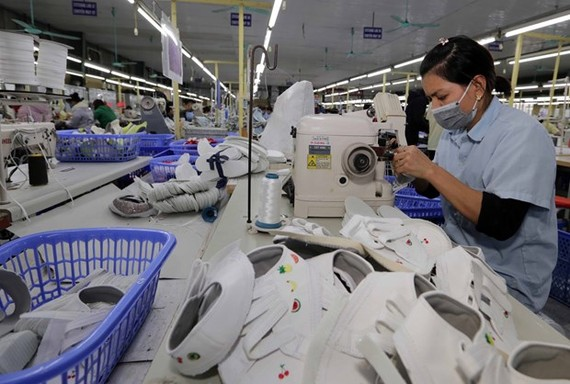 The shoe factory of the Ha Tay Chemical Weave Co. Ltd in Hanoi's Ba Vi district (Photo: VNA)