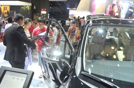Potential buyers reviewing cars' specs