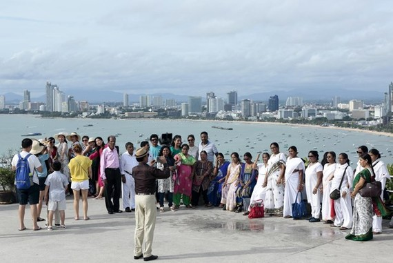 Tourists from India pose for pictures at Phra Tamnak Hill in Pattaya, Thailand. (Photo: Bangkok Post)
