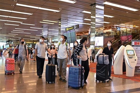Passengers at Singapore's Changi airport (Photo: AFP/VNA)