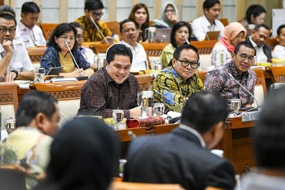 Indonesia's State-Owned Enterprises (SOEs) Minister Erick Thohir (front, left) sits with deputy minister Kartika Tiko Wirjoatmodjo (center) (Source: www.thejakartapost.com)