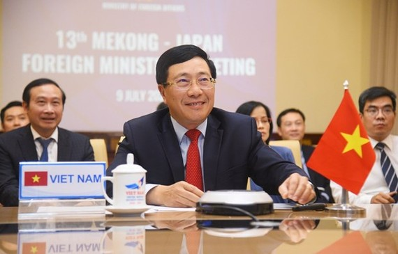 Vietnamese Deputy Prime Minister and Minister of Foreign Affairs Pham Binh Minh co-chairs the 13th Mekong - Japan Ministerial Conference on July 9 (Photo: VNA)