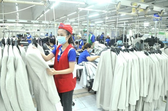 Making suits for export at Nha Be Garment Corporation