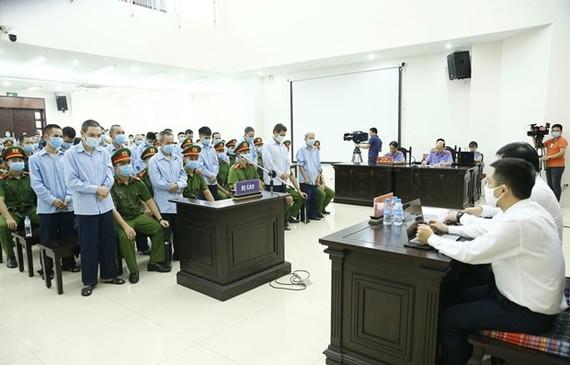 Defendants at the court (Source: VNA)