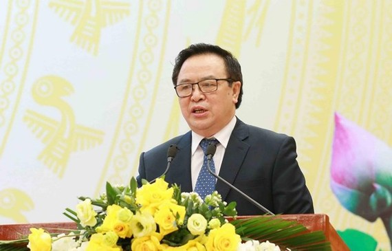 Hoang Binh Quan, Chairman of the Party Central Committee's Commission for External Relations, speaks at the meeting in Hanoi on February 3 (Photo: VNA)