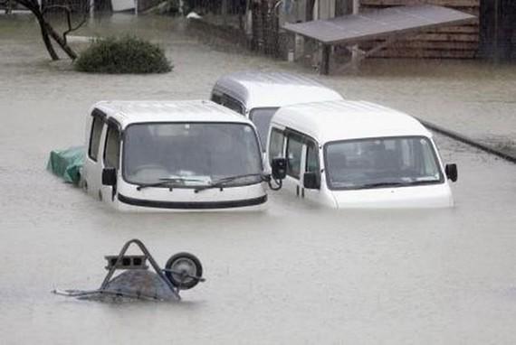 Cảnh ngập lụt do mưa lớn ảnh hưởng của siêu bão Hagibis tại Ise, tỉnh Mie, Nhật Bản, ngày 12-10. Ảnh: Kyodo/TTXVN
