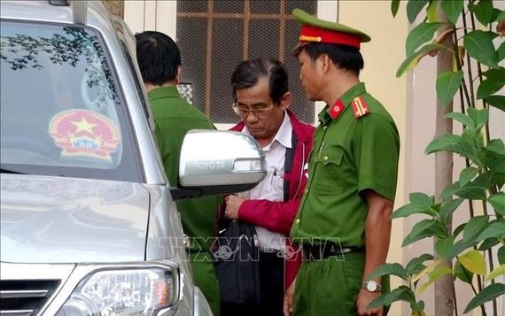 Ông Đỗ Ngọc Điệp tại cơ quan cảnh sát điều tra Công an tỉnh Bình Thuận vào chiều ngày 16-12