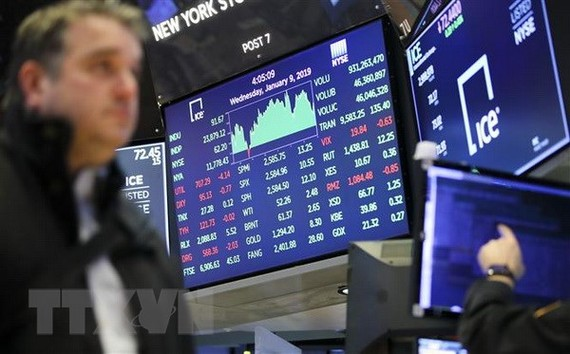 Bảng tỷ giá chứng khoán tại New York, Mỹ. Ảnh: THX/TTXVN