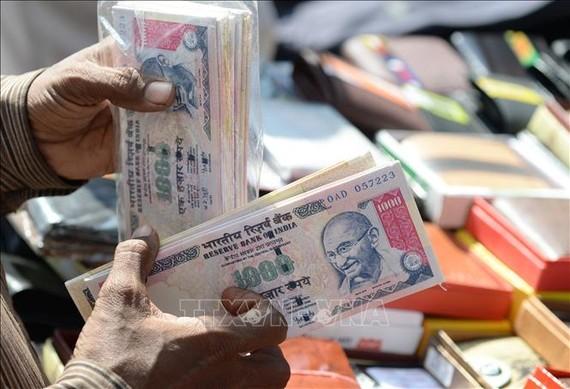 Đồng rupee của Ấn Độ. Ảnh: AFP/TTXVN