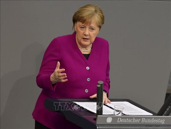 Thủ tướng Đức Angela Merkel phát biểu trong cuộc họp dịch về COVID-19 tại Berlin, ngày 23/4/2020. Ảnh: AFP/TTXVN