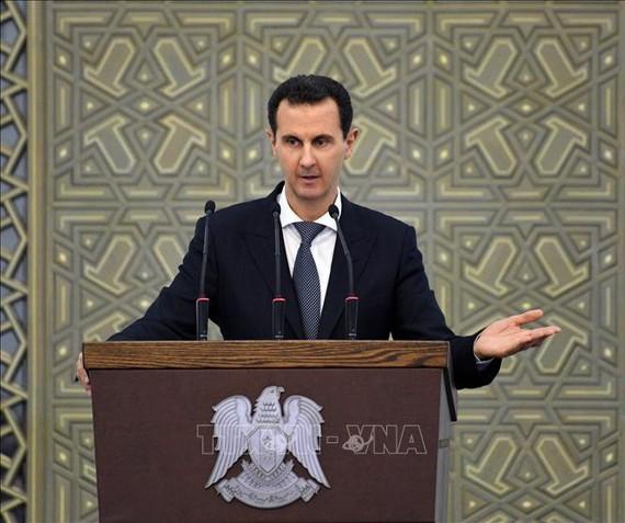 Tổng thống Syria Bashar al-Assad phát biểu tại Damascus. Ảnh: AFP/ TTXVN