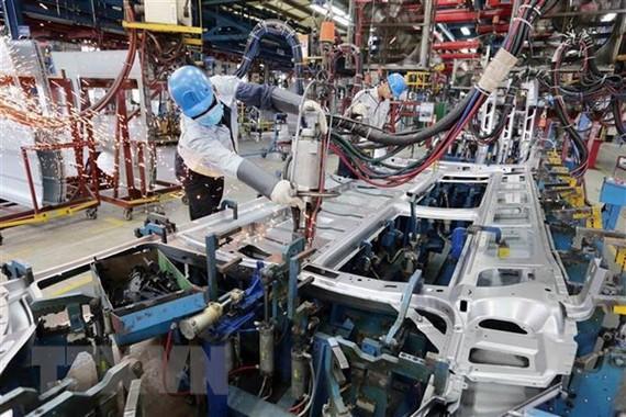 Việt Nam được cho là nền kinh tế duy nhất của khu vực sẽ đạt tăng trưởng dương trong năm 2020. Ảnh: TTXVN
