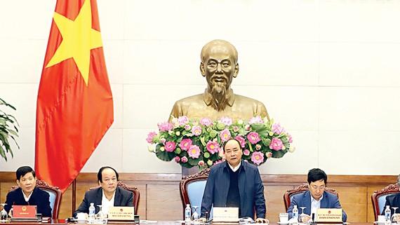 Thủ tướng Nguyễn Xuân Phúc phát biểu  chỉ đạo tại Hội nghị tổng kết quan hệ  Việt Nam - Lào năm 2017 và triển khai phương hướng hợp tác năm 2018 Ảnh: TTXVN