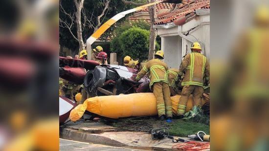 Hiện trường vụ rơi trực thăng tại Mỹ khiến ít nhất 3 người thiệt mạng. Ảnh: RT. COM