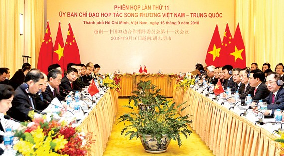 Đồng chí Phạm Bình Minh, Ủy viên Bộ Chính trị, Phó Thủ tướng Chính phủ, Bộ trưởng  Bộ Ngoại giao và Ủy viên Quốc vụ, Bộ trưởng Bộ Ngoại giao Trung Quốc Vương Nghị đồng chủ trì Phiên họp lần thứ 11 Ủy ban Chỉ đạo hợp tác song phương Việt Nam - Trung Quốc.