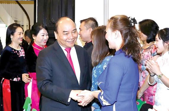 Thủ tướng Nguyễn Xuân Phúc và phu nhân gặp gỡ cộng đồng người Việt Nam tại Na Uy. Ảnh:TTXVN