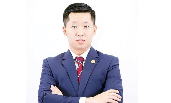 Ông Vũ Quốc Khánh - Phó Tổng Giám đốc phụ trách Khối ngân hàng Bưu điện