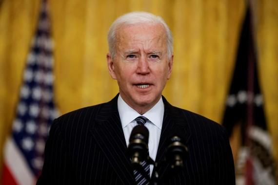 Chính quyền Tổng thống Joe Biden đã cam kết chia sẻ 80 triệu liều vắc xin với thế giới trước tháng 6. Ảnh: REUTERS