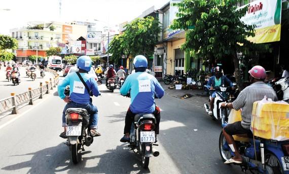 Uber hoạt động tại TPHCM                                                                                                   Ảnh: THÀNH TRÍ