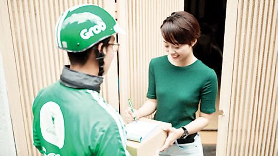 Grab và Shopee hợp tác triển khai Giao hàng 1h