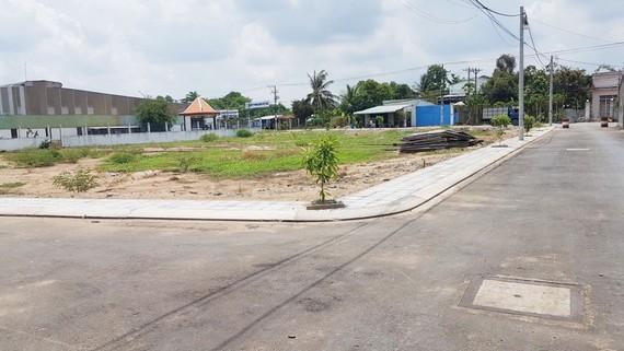 Một dự án phân lô, bán nền đã thực hiện tại huyện Bình Chánh, TPHCM. Ảnh: HUY LÊ